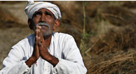 Indian farmer praying