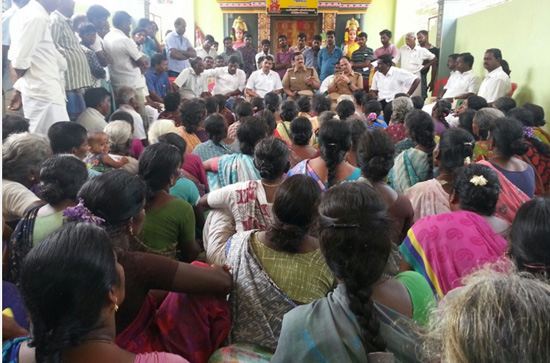 Protesting villagers at the village temple